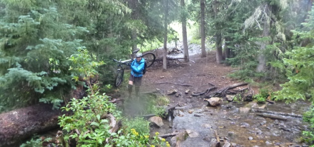 Mountain biking in the La Sals is Moab's sweet summer escape, even when things get torrential. So this is what rain jackets are for...